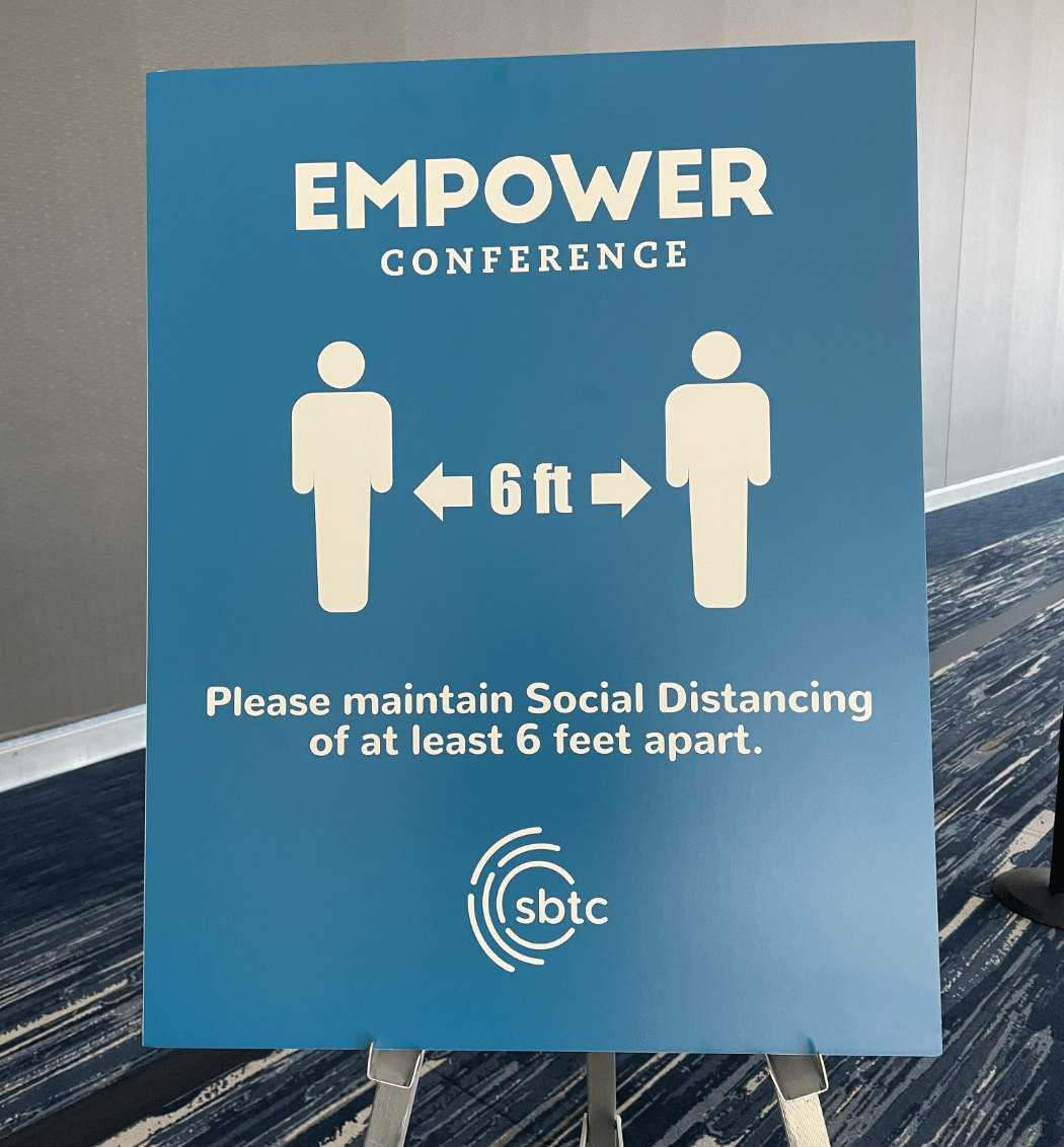 returning to in-person events safely - empower conference 6 feet apart signage